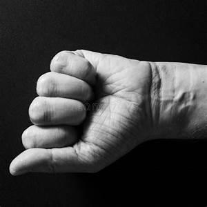 Fist With Wrist Tattoo In Greek Key Pattern Over Black
