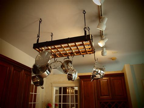 pot rack  lights  storage solution   small kitchen space homesfeed