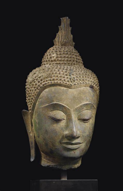 tete de bouddha tete de bouddha shakyamuni en bronze thailande style d ayutthaya xvieme siecle christie s
