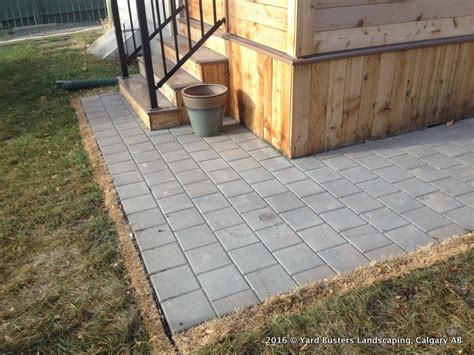unistone patio around deck 006 yard busters