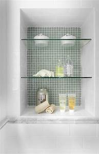 How do you secure the glass shelves in the shower niche?