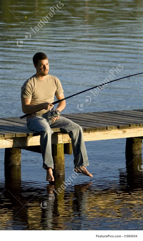 hunting  fishing man fishing   dock stock image