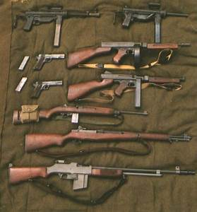 U.S. Army WWII weapons. (Top, bottom, L to Rt). Two .45cal ...