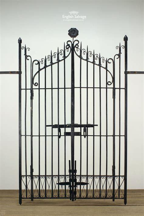 large black ornate wrought iron garden gates