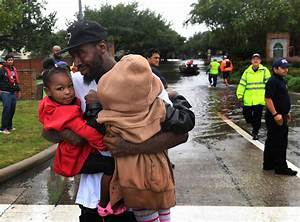 Photos Of Children Being Rescued From Flood Waters Will ...