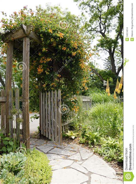 garden path  gate stock photo image  picket plants
