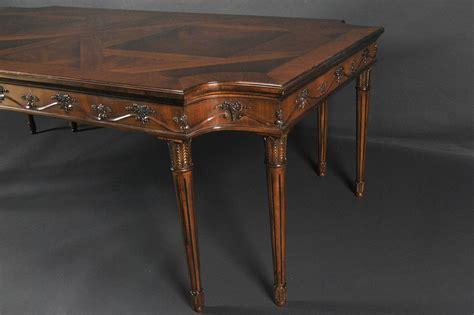 mahogany dining table  cut corners herringbone inlays