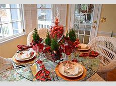 Santa Themed Tablescape with Santa Plates and a Sleigh