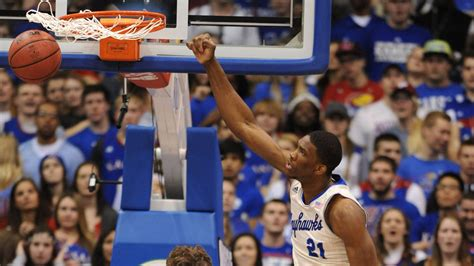 college basketball scores kansas clinches  straight