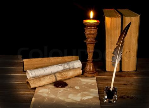 books   candle   black stock photo