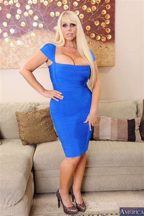 Karen Fisher in sexy dress stripping and showing off her big boobs - My Pornstar Book
