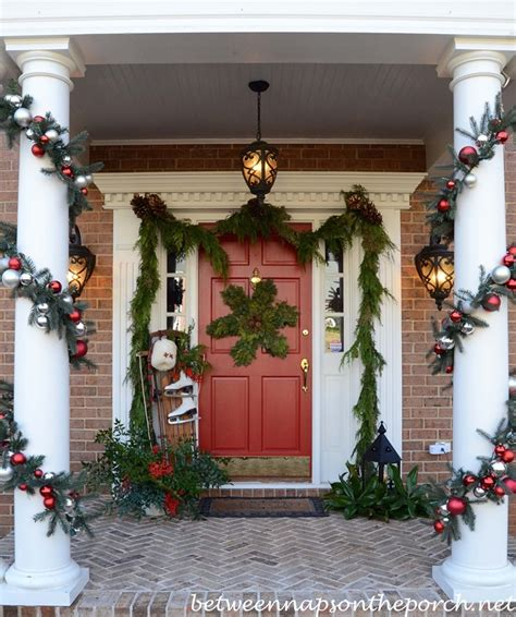 decorating porch column for xmas decorating the porch for with garland sled skates and snowflake wreath