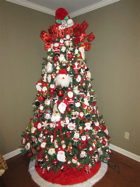 photo of santa claus and christmas tree santa tree santa claus tree santa