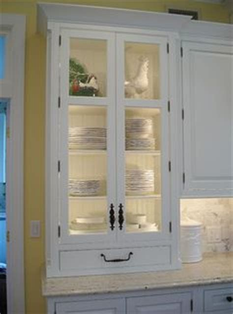 lighting inside kitchen cabinets 1000 images about cabinet lighting on glass 7052