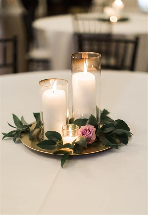 candle light dinner in dallas candle wedding centerpiece purple and greenery centerpiece