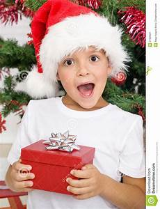 Happy Surprised Kid With Christmas Present Stock Image ...