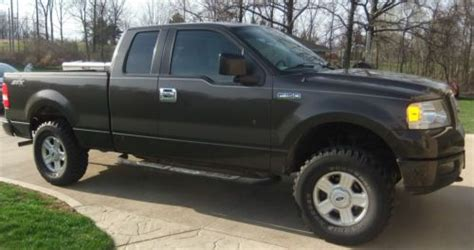 buy   ford   stx extended cab pickup  door