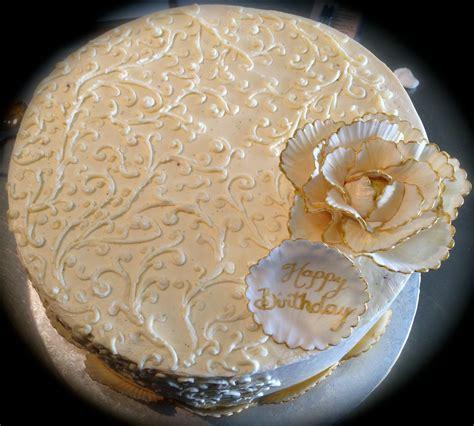 beautiful white  gold birthday cake  filigree
