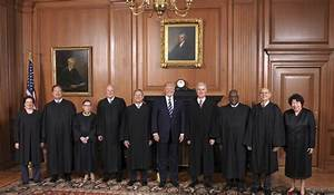 In this image provided by the Supreme Court, President ...