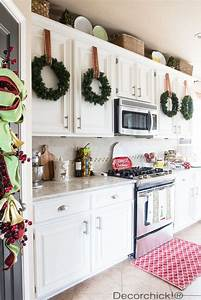 23 captivating n charming christmas kitchen decor ideas With kitchen cabinets lowes with santa claus wall art