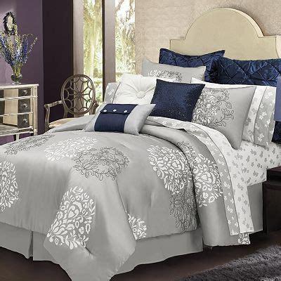 love  silver bed set   blue accent pillows   floral sheet set master
