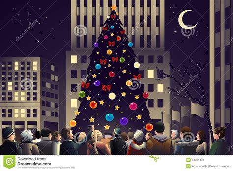 apriete en la ciudad cerca del 225 rbol de navidad encendido