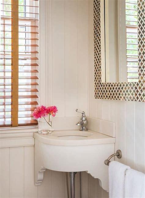 Wood Quatrefoil Mirror Over Pedestal Sink   Transitional