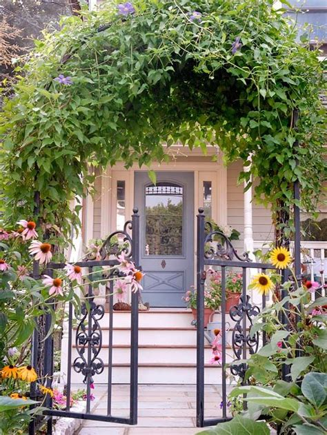 front yard arbor love this vine covered arbor and wrought iron gates and front door more front yard flower