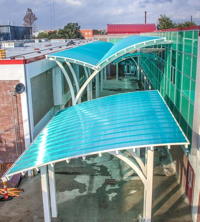 translucent canopies provide shelter connect high school    addition retrofit