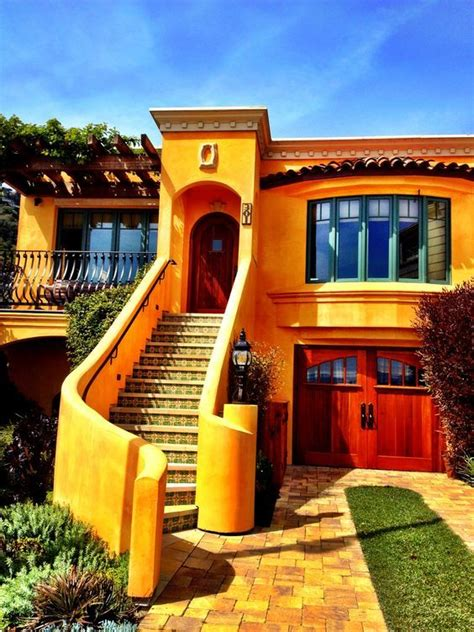 spanish style house stucco flat roof yellow with green