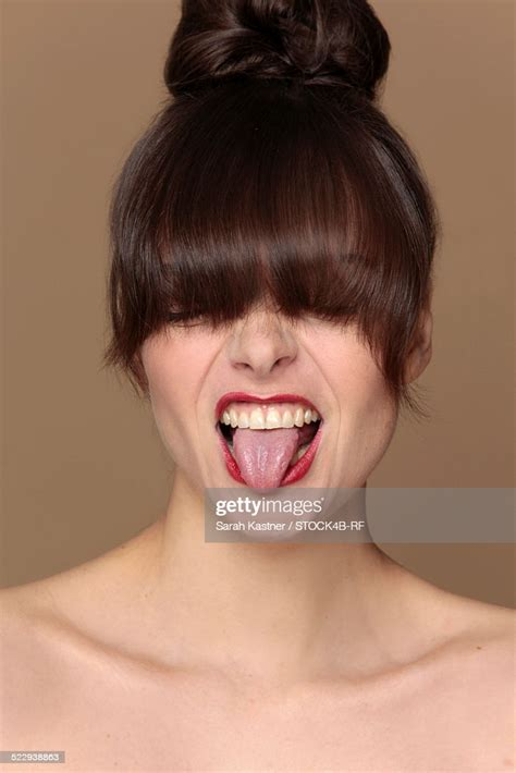 Brunette Woman Sticking Out Tongue Stock Photo Getty Images