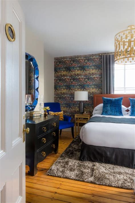 eclectic bedroom  royal blue accents feather design