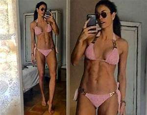 Melanie Sykes, 46, flashes SERIOUS cleavage as she strips ...