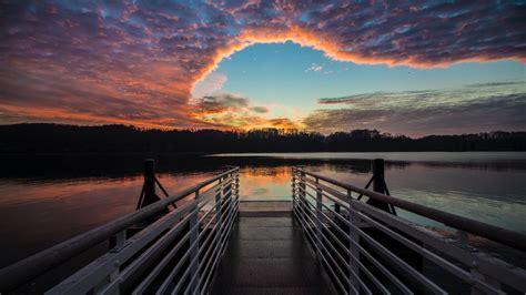 wallpaper  pier lake sunset clouds