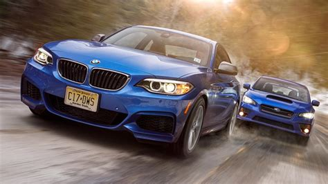 Subaru Vs Bmw by The Bmw 235i Takes On The Subaru Wrx Sti