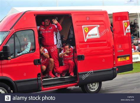 ferrari minivan the ferrari f1 team mechanics wave from a van at the