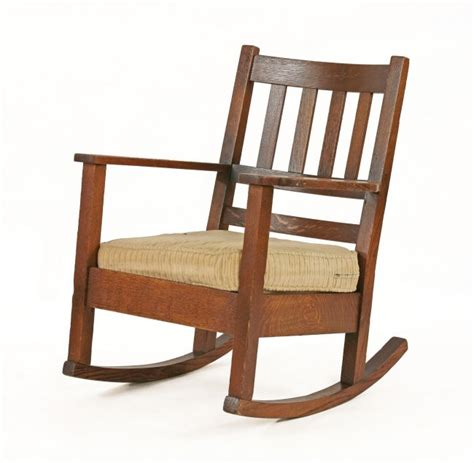 an oak type rocking chair with a lot 272