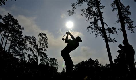 Tiger Woods tees off on the 14th hole during a practice ...