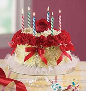 LIght yellow, white and red flowers with birthday cake ...