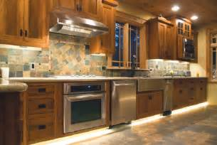 two kitchens four lighting ideas design center - Hardware For Kitchen Cabinets Ideas