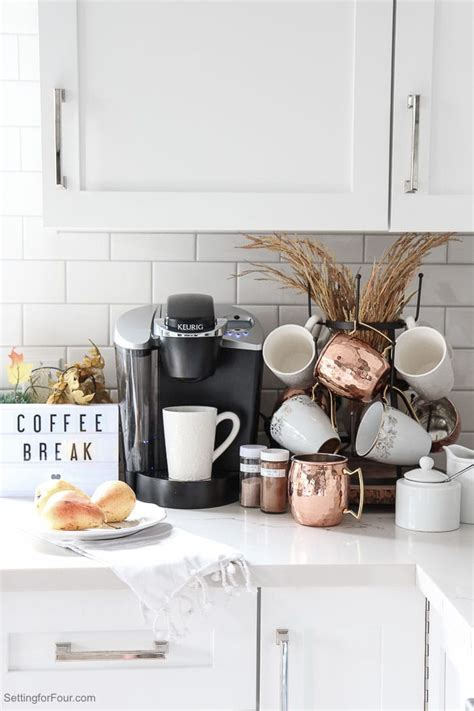 This sleek, modern breakfast bar saves on kitchen or dining room space and gives a cozy feeling. An Elegant Kitchen Coffee Bar Idea for Fall - Setting for Four
