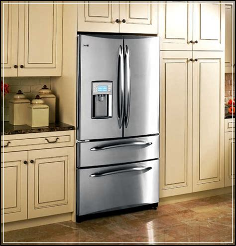 how to build kitchen island the top 5 regular counter cabinet depth refrigerator to