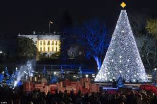 obama and the first family light the national christmas tree at the white house daily mail online