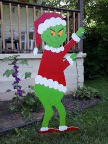 grinch christmas standing grinch stealing lights outdoor
