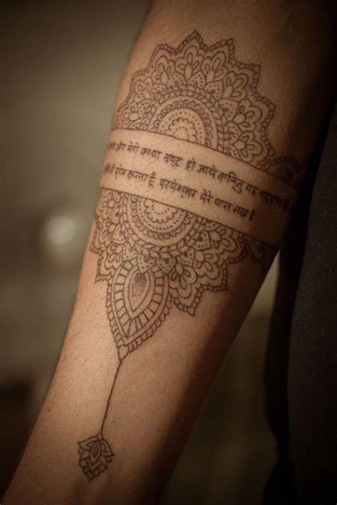 rangoli brown ink tattoo psalm   hindi script fine