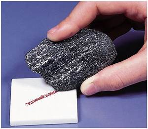 3). Reddish brown streak of hematite