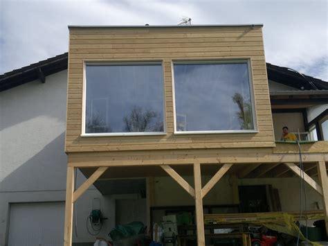 maison en ossature bois sur pilotis avec bardage sur l extension en bois abt construction bois