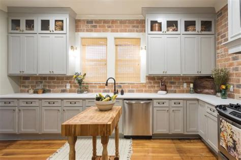 contemporary neutral kitchen  brown brick backsplash