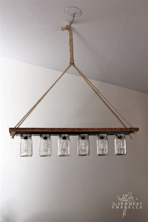 remodelaholic upcycle vanity light strip hanging