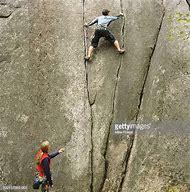 Woman Rock Climbing Wall